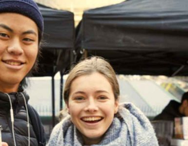 Couple smiling in front of Refugee week